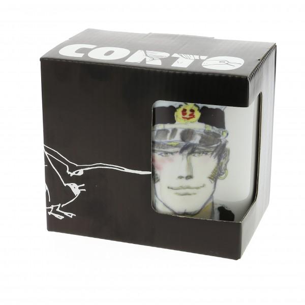 Tazza con manico, in porcellana bianca, con disegno ad acquerello del volto di Corto Maltese